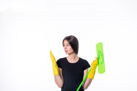 Cleaning girl happy excited during cleaning. Funny girl with cleaning mop isolated on white background