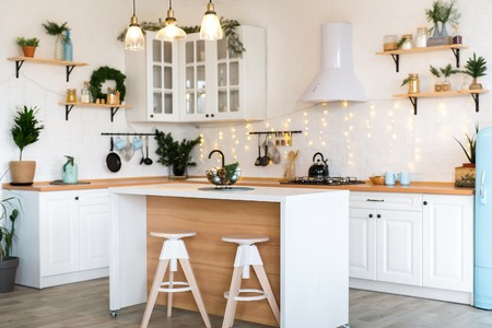 Modern Kitchen Interior with Island, Sink, Cabinets in New Luxury Home Decorated in Christmas Style. Standard-Bild - 112972380