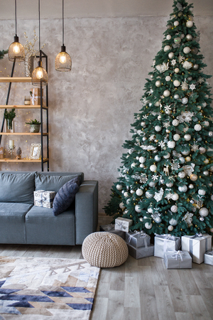 Interior of modern living room with comfortable sofa decorated with Christmas tree and gifts Standard-Bild - 112972384