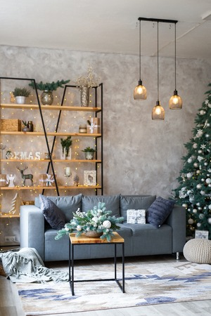 Interior of modern living room with comfortable sofa decorated with Christmas tree and gifts Standard-Bild - 112972385