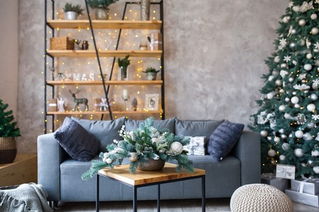 Interior of modern living room with comfortable sofa decorated with Christmas tree and gifts Standard-Bild - 112972387