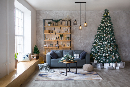 Interior of modern living room with comfortable sofa decorated with Christmas tree and gifts Standard-Bild - 112972521