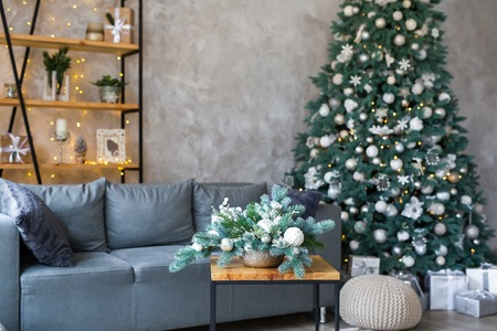 Interior of modern living room with comfortable sofa decorated with Christmas tree and gifts Standard-Bild - 112972524