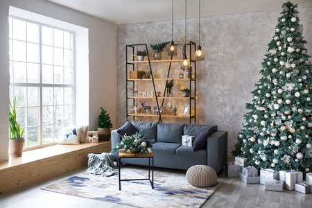 Interior of modern living room with comfortable sofa decorated with Christmas tree and gifts Standard-Bild - 112972558
