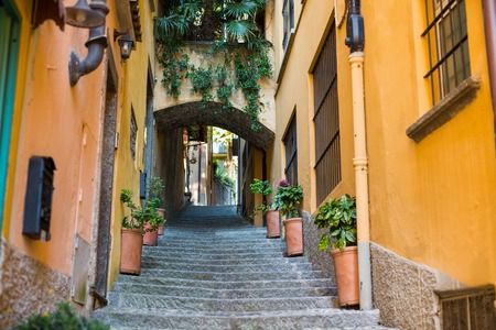 Old picturesque street with amazing view in beautiful Bellagio, Como lake, Italy 스톡 콘텐츠