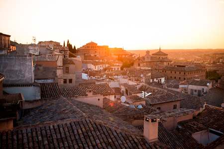 Sunset over roofs of old houses in Toledo - an ancient city with beautiful architecture near Madrid, Spain, Europe