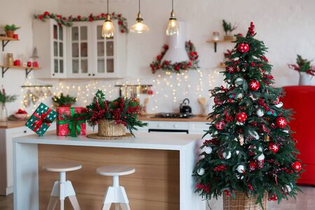 Modern Kitchen Interior with Island, Sink, Cabinets in New Luxury Home Decorated in Christmas Style.