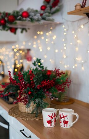 Photo of Christmas table decoration, festive dinnerware with lights and for tea in decorated dinner room, luxury utensil, New Year party. Christmas time table setting, xmas decor