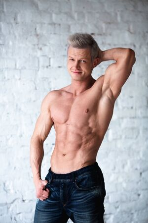 Portrait of shirtless muscular man in a jeans. Standard-Bild - 148957510