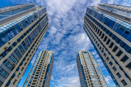property development: Looking up at residential business buildings (towers)