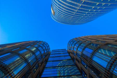 property development: Looking up at blue glass business building