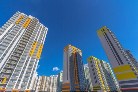 Some residential buildings with sky at background