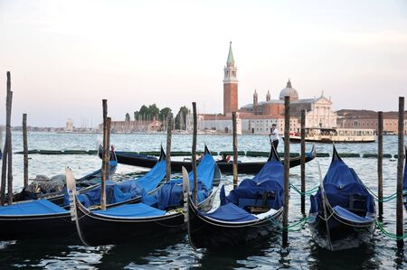 Gondolas moored to pole in the Grand Canal of Venice