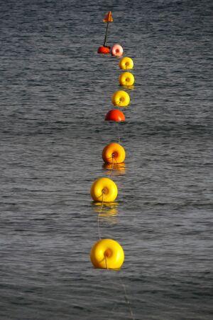 Yellow buoys wire in the blue sea of Mandriola (Sardinia - Italy) Stock Photo