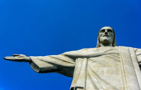 RIO DE JANEIRO, BRAZIL - JANUARY 07, 2017: View of the top part of Christ the Redeemer at sunny day with deep blue sky, an Art Deco statue of Jesus Christ, one of the New Seven Wonders of the World Editorial