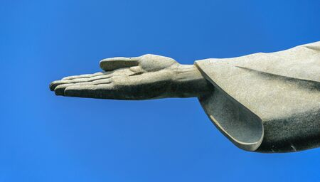 Detail of the right hand of Christ the Redeemer statue located at the peak of Corcovado mountain in the Tijuca Forest National Park overlooking the city of Rio de Janeiro, Brazil