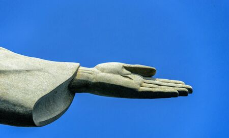 Detail of the left hand of Christ the Redeemer statue located at the peak of Corcovado mountain in the Tijuca Forest National Park overlooking the city of Rio de Janeiro, Brazil