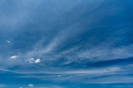Beautiful vast sky deep blue color with white spindrift clouds at sunny summer day Imagens