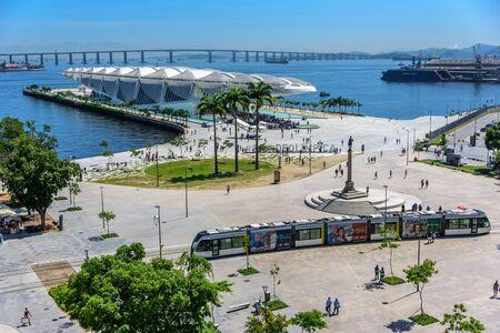 RIO DE JANEIRO, BRAZIL - DECEMBER 28, 2016: Aerial view of the Museum of Tomorrow, Light Rail passing Maua Square and Porto Maravilha with Rio-Niteroi Bridge on the background