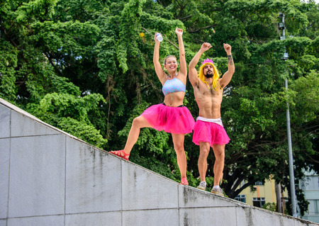RIO DE JANEIRO, BRAZIL - FEBRUARY 28, 2017: Two ballerinas, male and female, in bright pink tutu skirts standing at the Memorial Getulio Vargas, Gloria neighborhood at Carnaval 2017