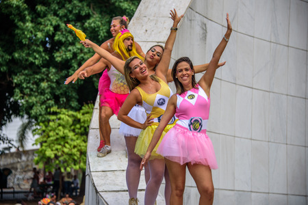 RIO DE JANEIRO, BRAZIL - FEBRUARY 28, 2017: People in bright tutu skirts standing at the Memorial Getulio Vargas, Gloria neighborhood at Carnaval 2017 Redakční