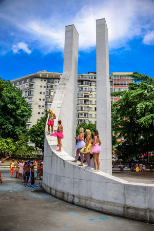 RIO DE JANEIRO, BRAZIL - FEBRUARY 28, 2017: Young women in bright tutu skirts standing at the Memorial Getulio Vargas of Praca Luis de Camoes, Gloria neighborhood at Carnaval 2017