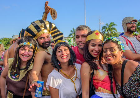 RIO DE JANEIRO, BRAZIL - FEBRUARY 28, 2017: Happy people in costumes of Egypt Pharaoh, Cleopatra, Wonder Woman and Frida Kahlo with unibrow at Bloco Orquestra Voadora in Flamengo Park, Carnaval 2017