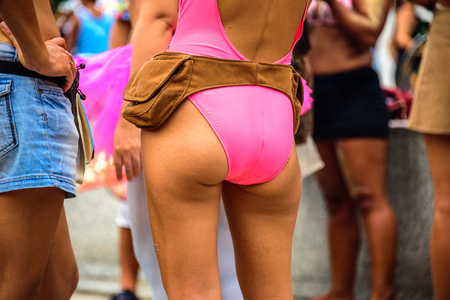 Beautiful woman butt in pink leotard with brown hip bag at Bloco Orquestra Voadora, Carnaval 2017 Reklamní fotografie