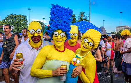 marge: RIO DE JANEIRO, BRAZIL - FEBRUARY 28, 2017: Costumed family of the Simpsons with Homer, Marge, Bart, Lisa and Maggie at Bloco Orquestra Voadora in Flamengo Park, Carnaval 2017 Editorial