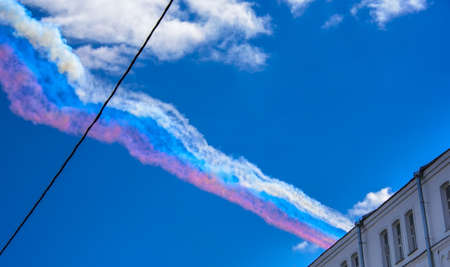 Trail of smoke in the colors of Russian flag left by Russian Su-25 attack aircrafts on parade in honor of Victory in the Great Patriotic War, Moscow city