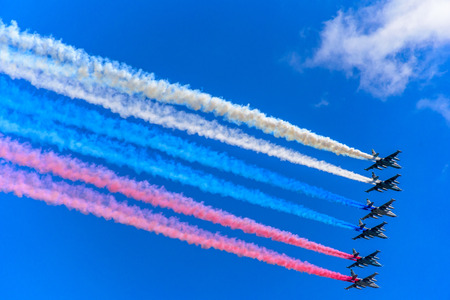 MOSCOW, RUSSIA - MAY 07, 2017: Six Su-25 assault aircrafts leaving smoke in the colors of Russian flag in the sky at the rehearsal for the Victory Day military parade