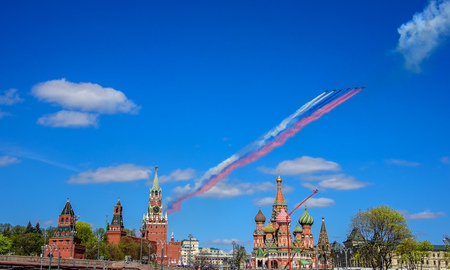 MOSCOW, RUSSIA - MAY 07, 2017: Su-25 assault aircrafts leaving smoke as tricolor Russian flag above the Kremlin, Red Square and St Basils Church at the rehearsal for the Victory Day military parade