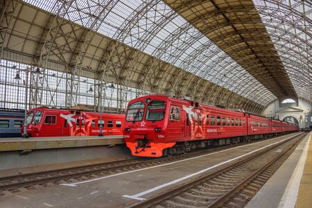 MOSCOW, RUSSIA - MAY 05, 2017: Two red Aeroexpress trains standing at a gigantic landing platform of Moscow Kiyevskaya railway station and Shukhovs steel-and-glass roof of Kiyevsky station