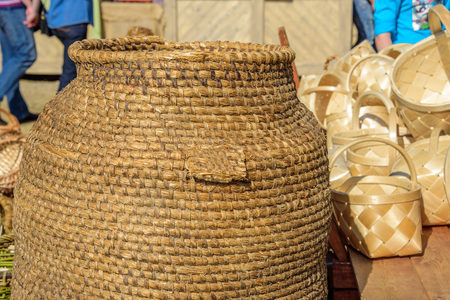 Handmade braided barrel and wicker baskets at international knight festival Tournament of Saint George in the Kolomenskoye museum-reserve Reklamní fotografie - 84794428