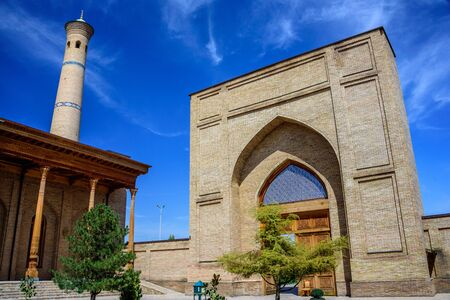 Mosque with carved columns of sandalwood, minaret and entrance of Hazrat Imam Ensemble in the center of Tashkent city, Uzbekistan