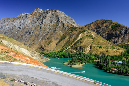 Panoramic view of Charvak Lake, a huge artificial lake-reservoir with azure water created by erecting a high stone dam on the Chirchiq River, located in Tashkent region of Uzbekistan