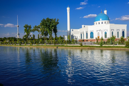 The White Mosque Minor with turquoise dome, one of new sights of Tashkent, located in the new part of the city on the embankment of the Ankhor channel and is surrounded by a landscaped area