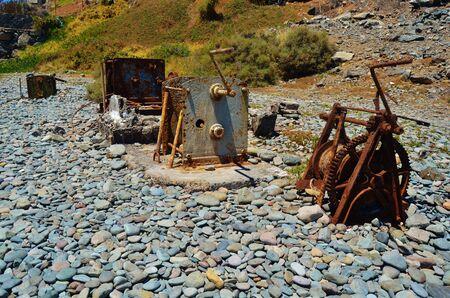 Old winches in a beach Foto de archivo