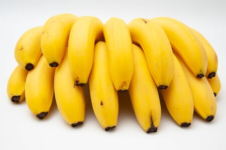 Banana cluster isolated on white background. Front view.