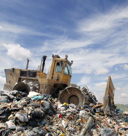 landfill: The bulldozer buries food and industrial wastes