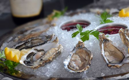 Oysters in ice with a lemon and photo