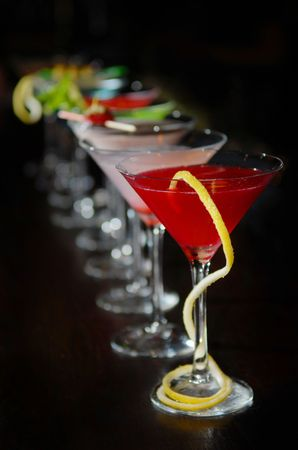 Cocktails in martini glasses stand among Stock Photo - 5221699