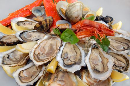 seafood with claws of the Kamchatka crab, oysters photo