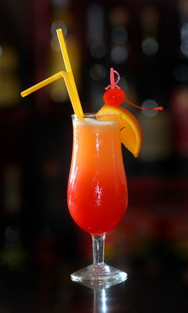 It is red - an orange cocktail in the big glass Stock Photo - 5256935