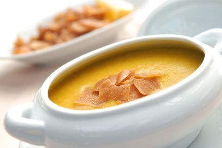 Lentil soup with crackers in a white bowl Stock Photo
