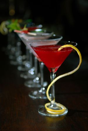 Cocktails in martini glasses stand among Stock Photo - 5279294