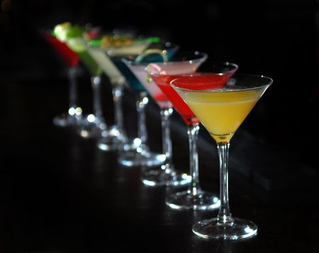 Cocktails in martini glasses stand among Stock Photo - 5287821