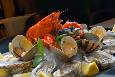 A cocktail from seafood with lobster and oysters photo