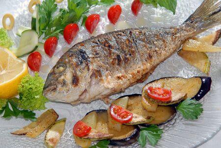 Fried fish dorado with vegetables Stock Photo - 5341529