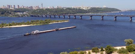 dnepr: Panorama of Kiev and the river Dnepr with the barge